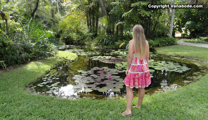 girl at waterlily pond in mckees gardens
