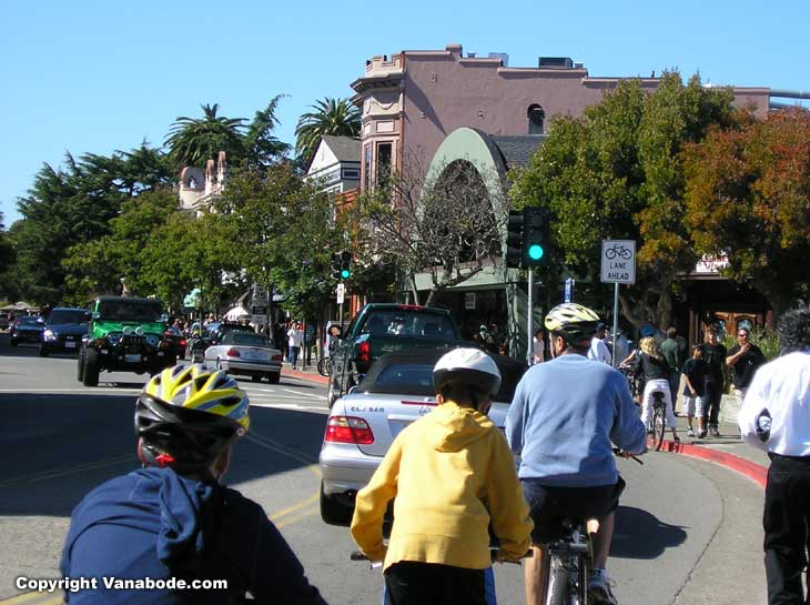 shows crowded busy streets of saualiot california, bikers, walkers, vendors and cars
