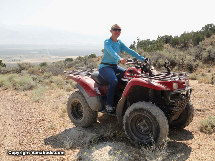 pretty blonde riding offroad in the desert on an atv